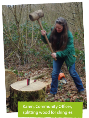 Karen, Community Officer splitting wood for shingles